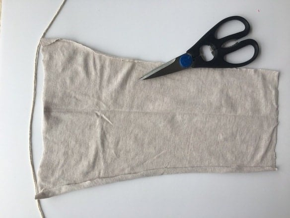 cream piece of fabric with scissors on top