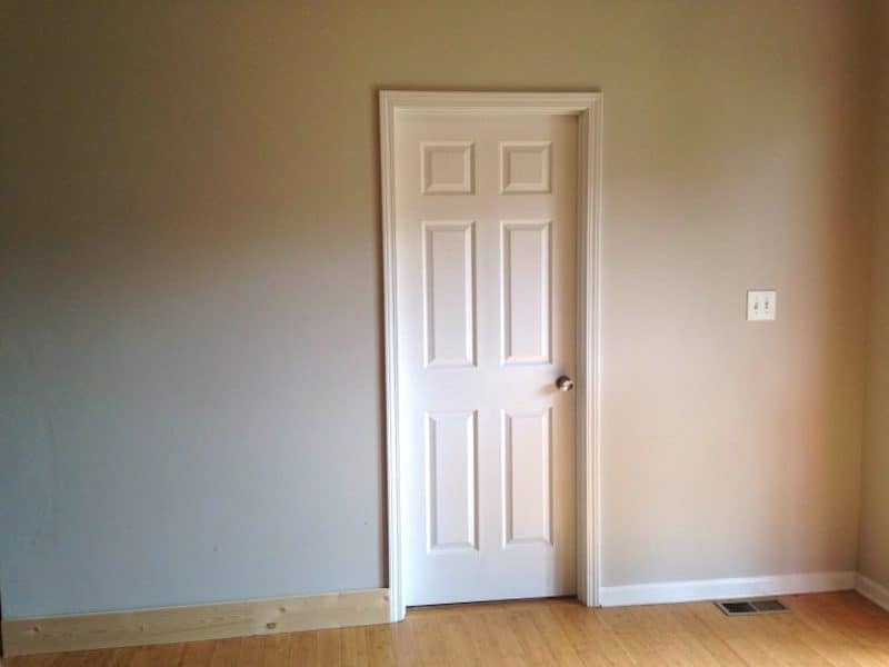 blank wall with a door