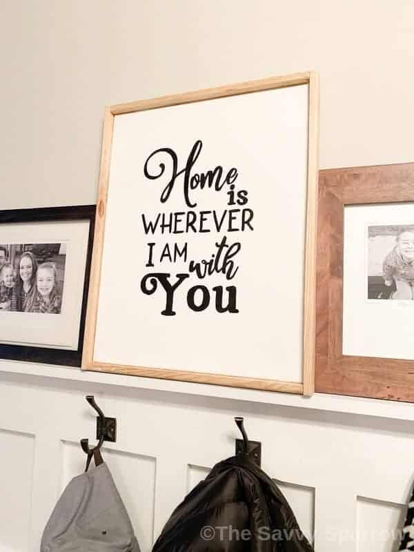 "DIY sign on canvas with wood frame that says ""Home is wherever I am with you"""