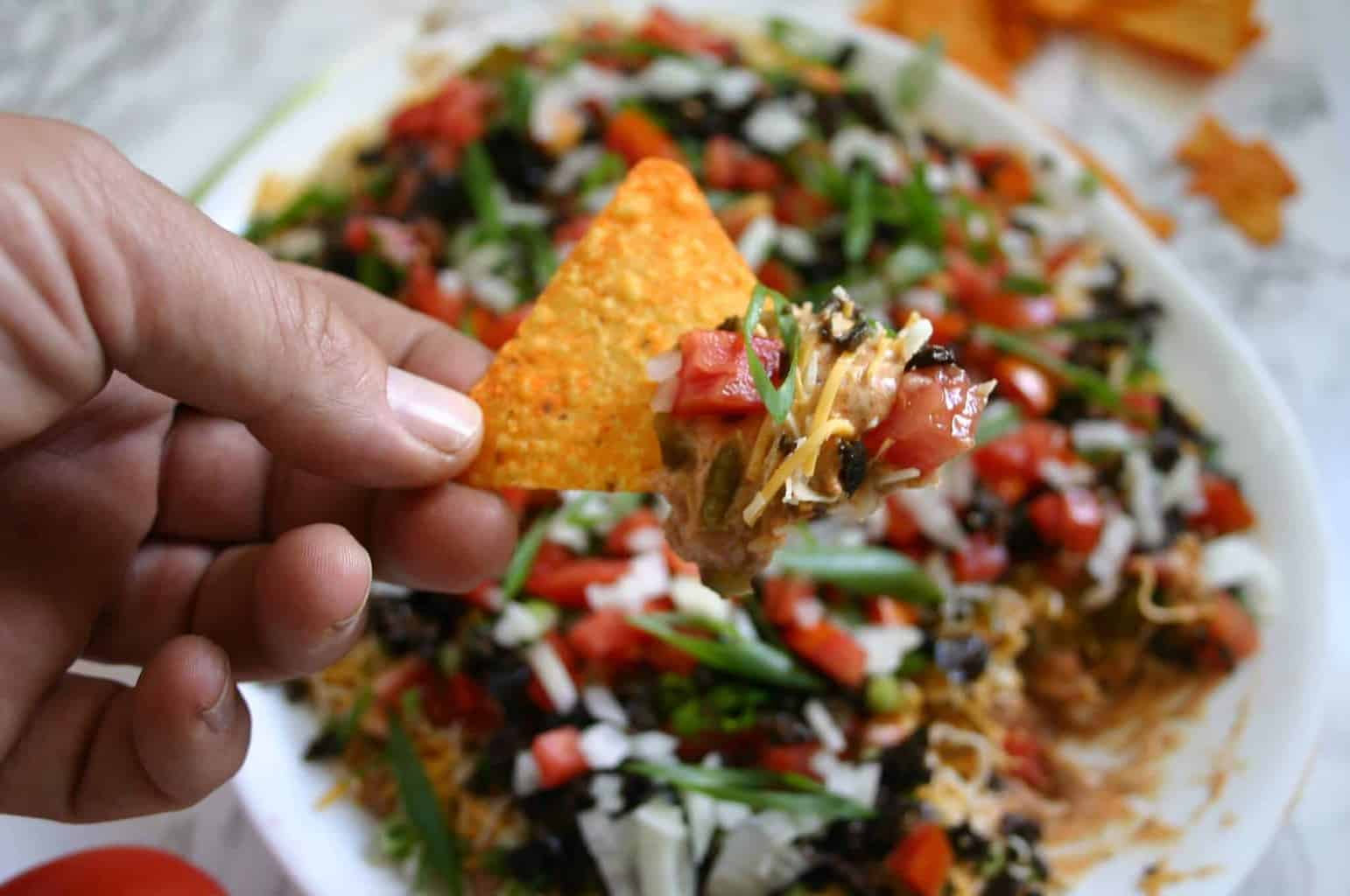The best easy taco dip recipe - The perfect easy football party food!