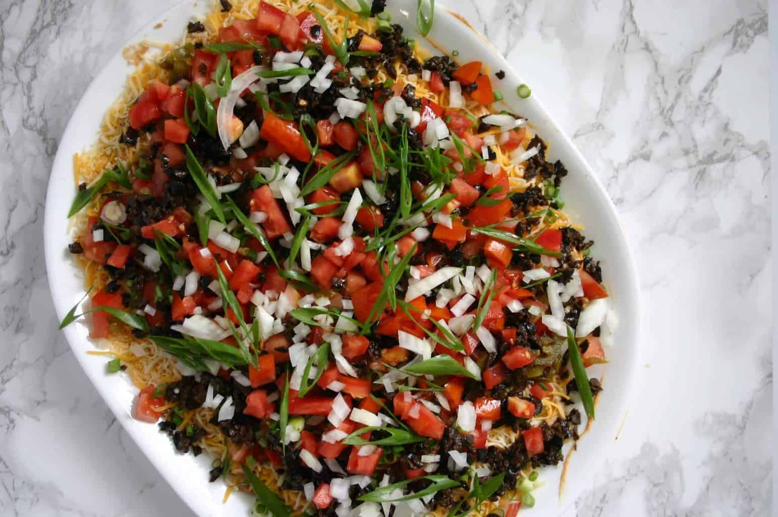 The best easy taco dip recipe - The perfect football party food!
