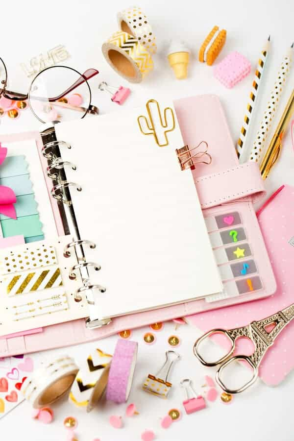 open planner on a desk with colorful planner accessories