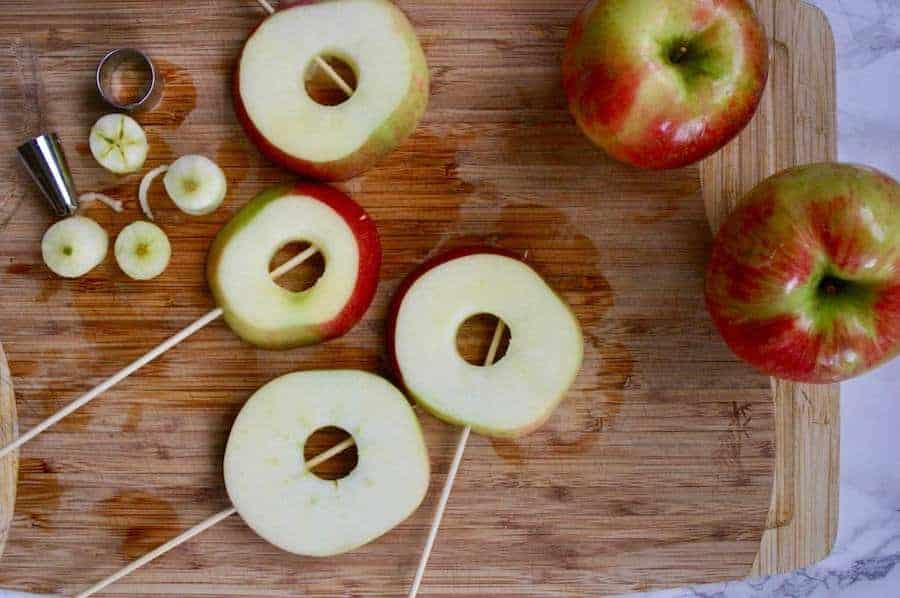 apple slices on wooden skewers