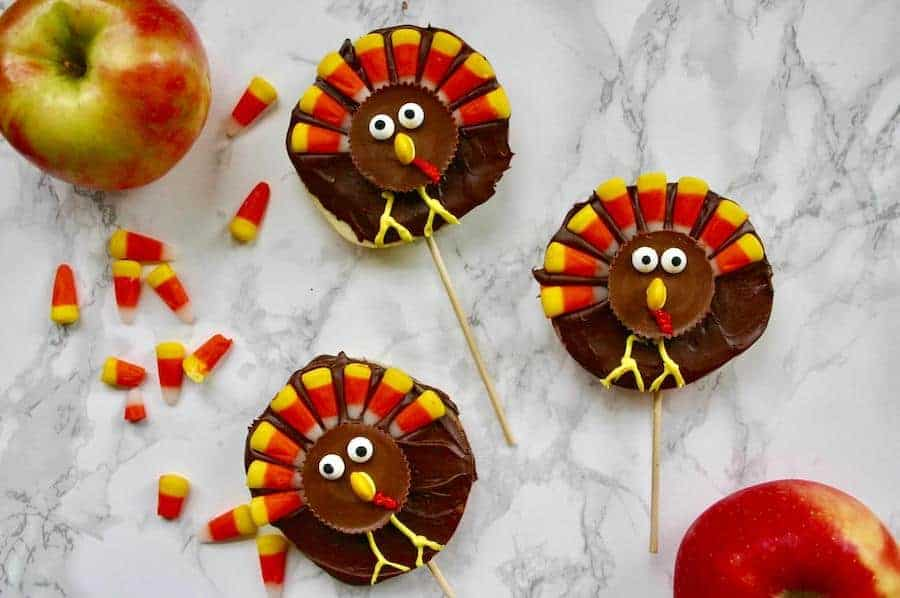 chocolate dipped apple slices decorated to look like turkeys