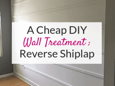 Want an easy DIY wall treatment idea to decorate a large blank wall? Try a DIY reverse shiplap wall! Find out how to make this reverse shiplap wall treatment for under $75!