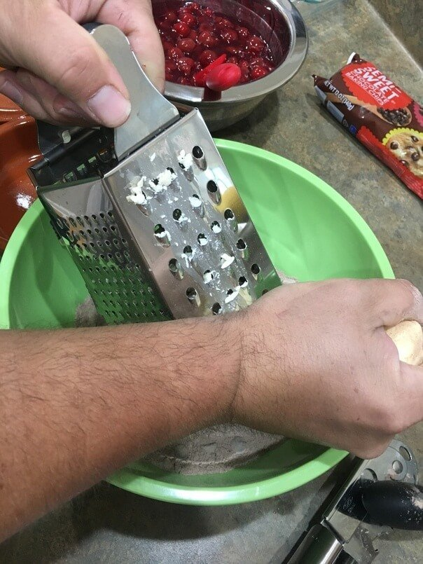 Grate frozen butter for dump cake recipes