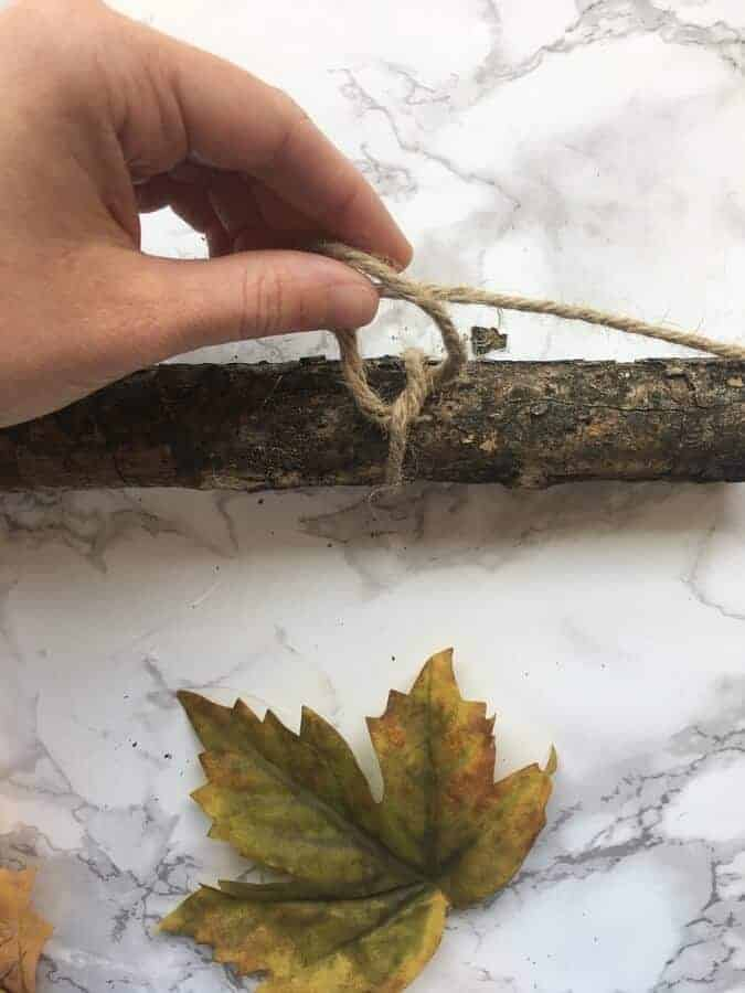 how to make an easy DIY wall hanging with a stick and fall leaves