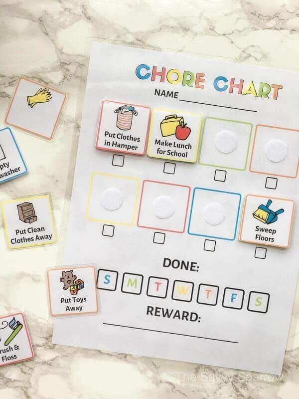 kids chore chart and chore cards laying on a table