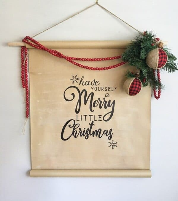 DIY scroll sign that says Merry Christmas