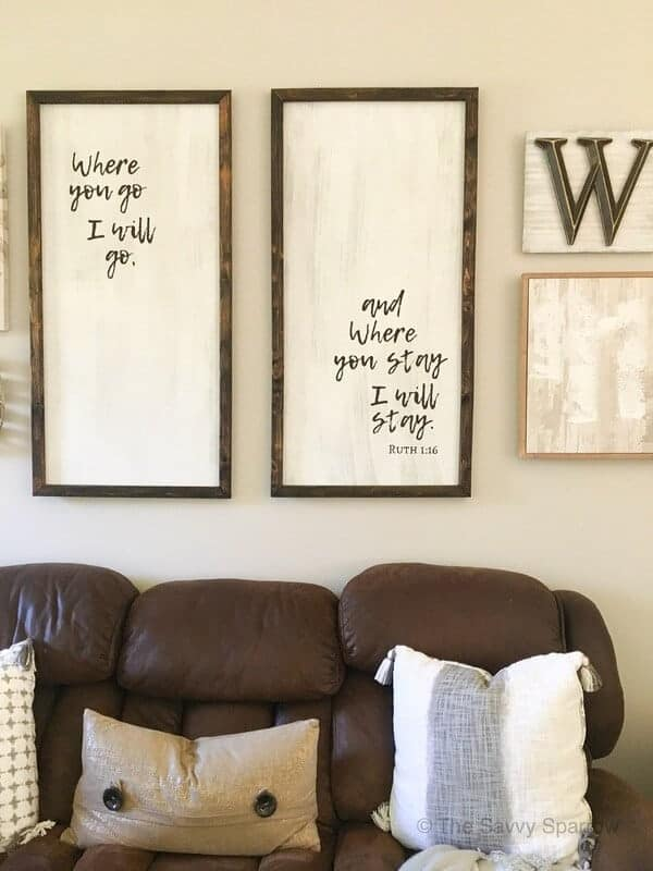 DIY wood signs hanging on a wall with other neutral art work