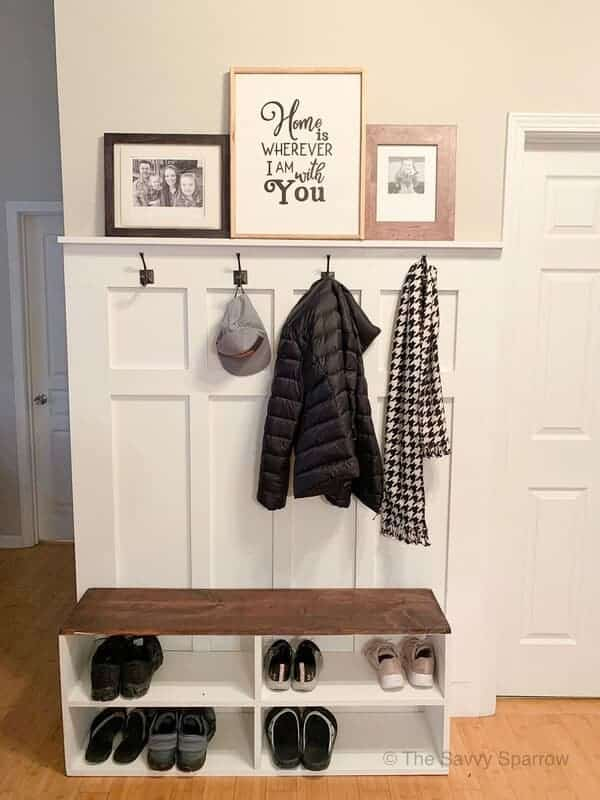 DIY mudroom wall with hooks for storage