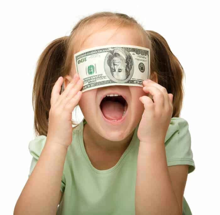 little girl with 100 dollar bill