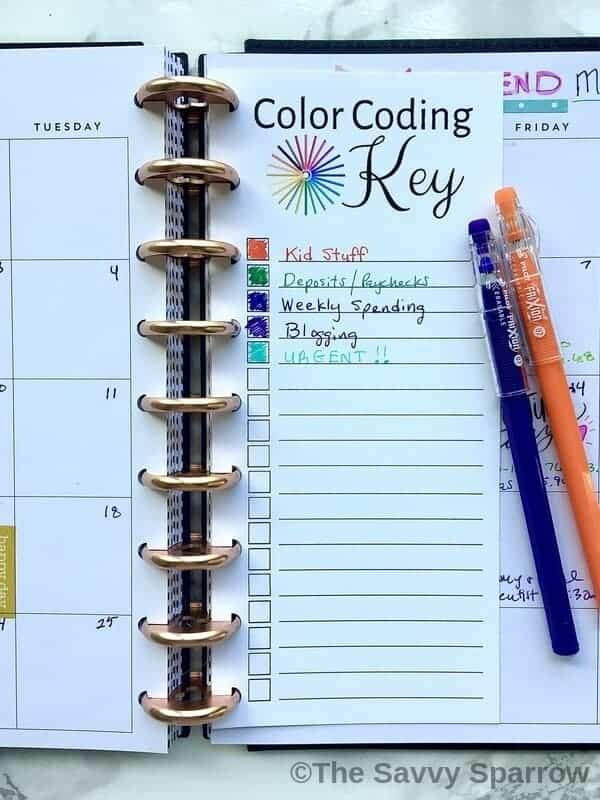 "half sheet of paper inside a planner that says ""Color Coding Key"""