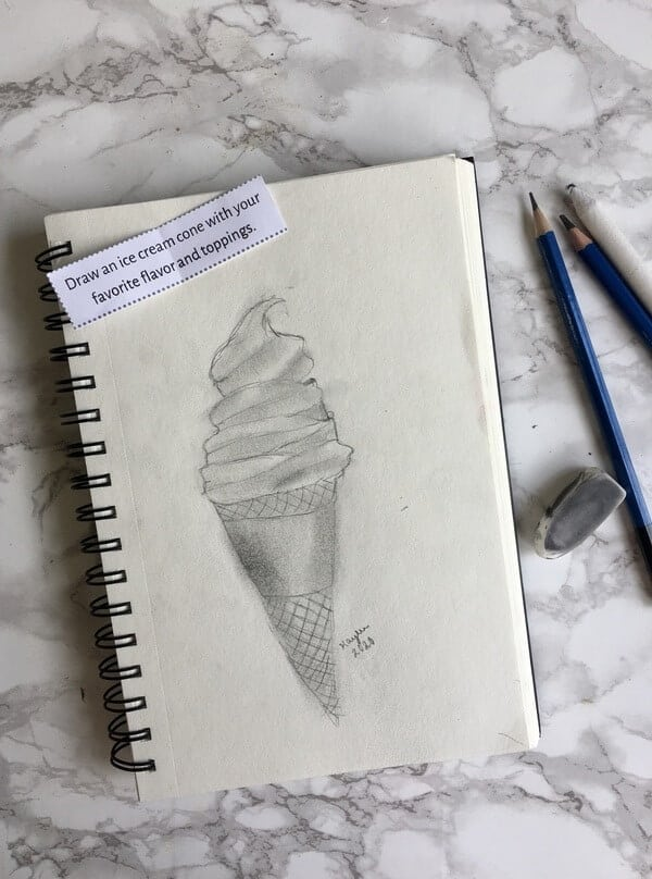 pencil drawing of ice cream cone in a sketch pad