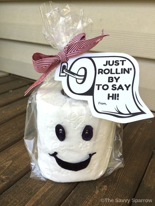 Toilet paper gift wrapped in cellophane bag with gift tag