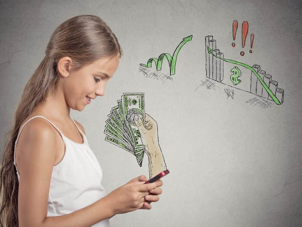 teen girl looking at a cell phone with money symbols in the background