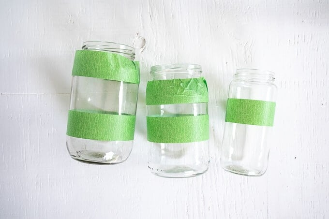 3 mason jars with green painter's tape stripes around them
