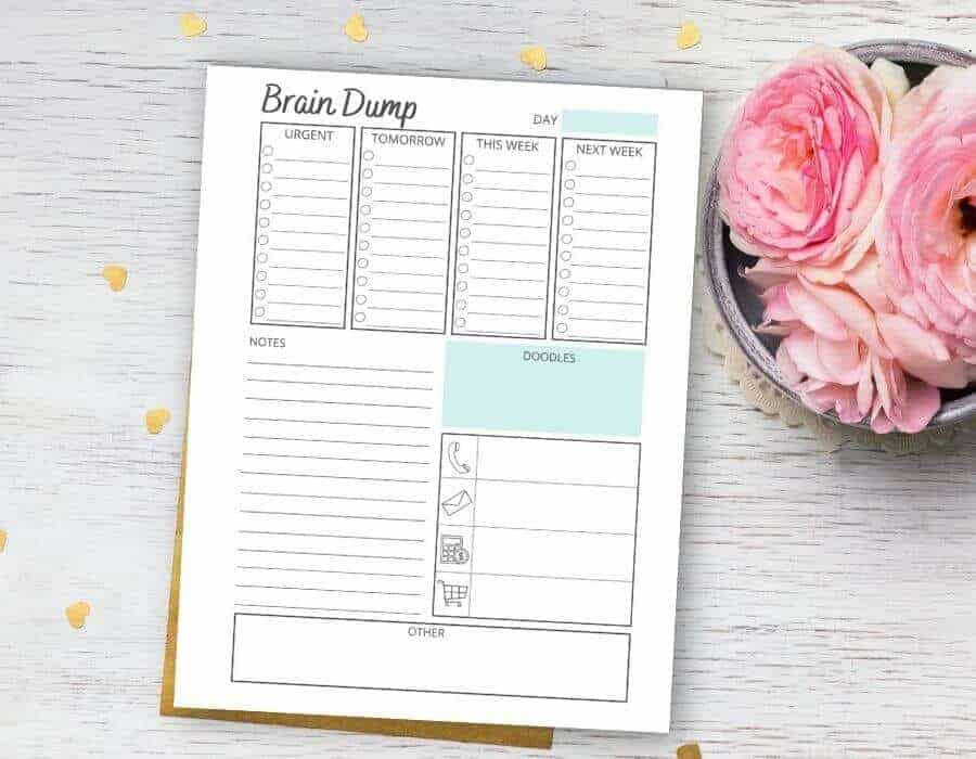 printable brain dump template on a table with pink flowers
