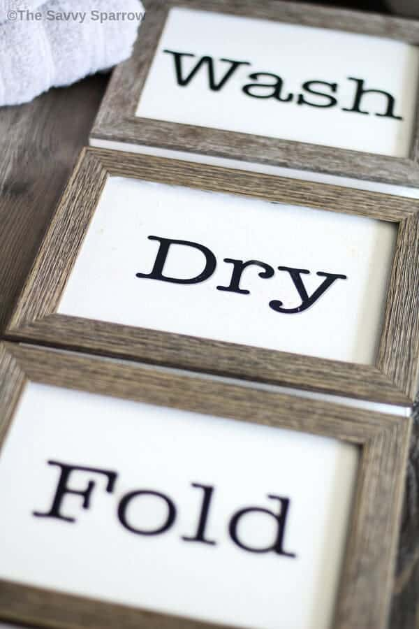 wash dry fold signs laying on a table