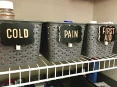 labeled storage baskets of medicine and first aid supplies