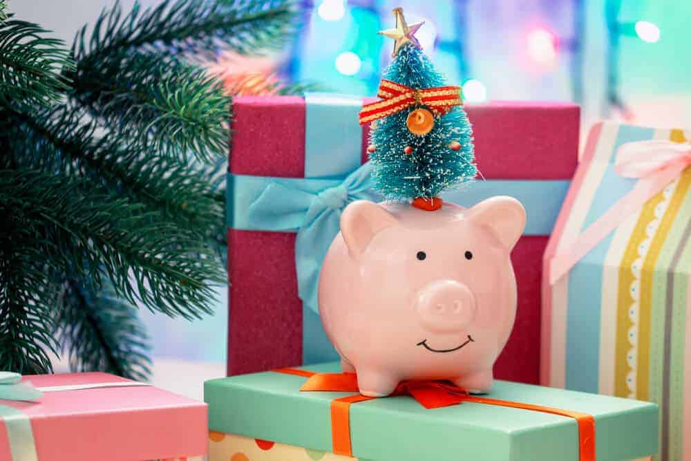 piggy bank on top of Christmas presents