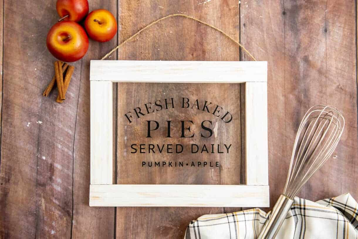 DIY Fall sign on a table with apples and a whisk