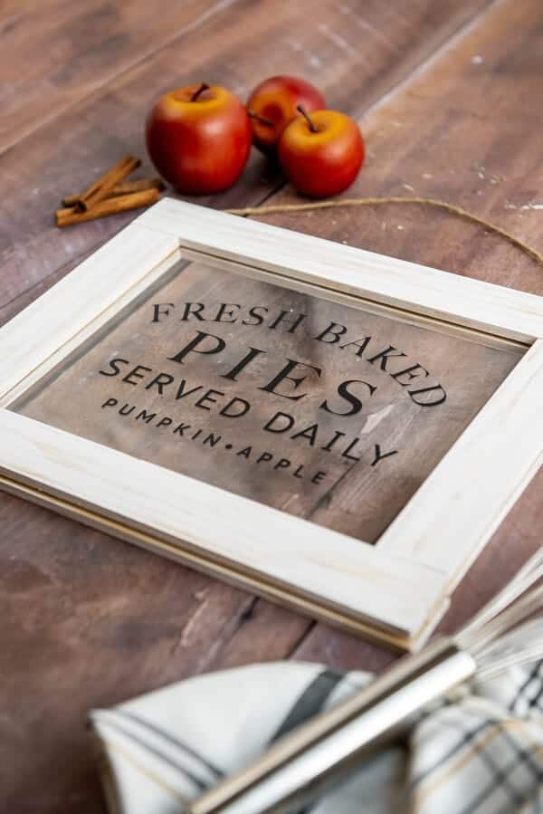 Cricut DIY fall sing on a table with apples and a whisk