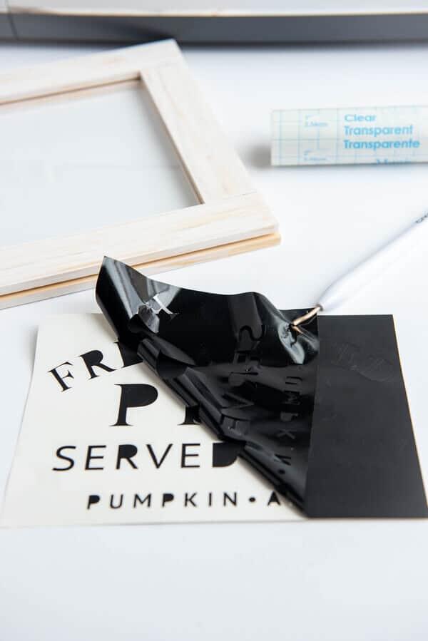weeding black vinyl from free fall SVG design