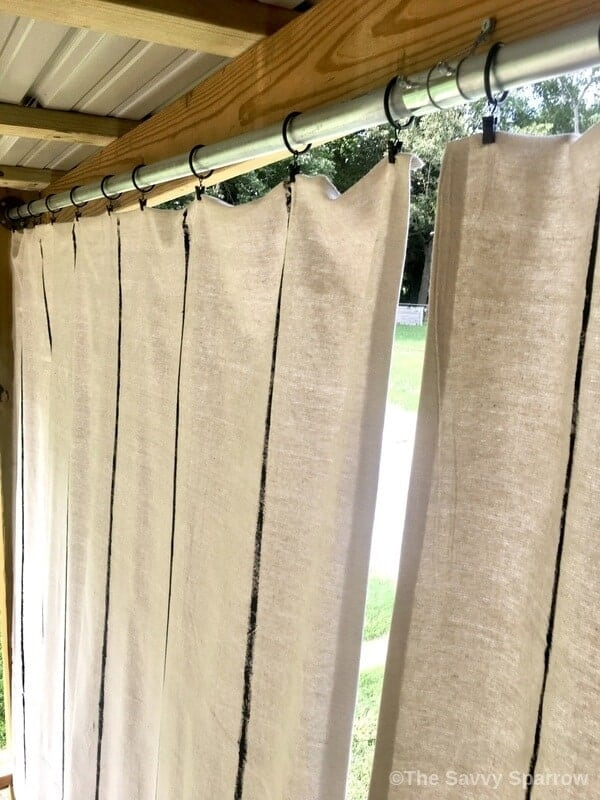 top of drop cloth curtains hung up with curtain clips
