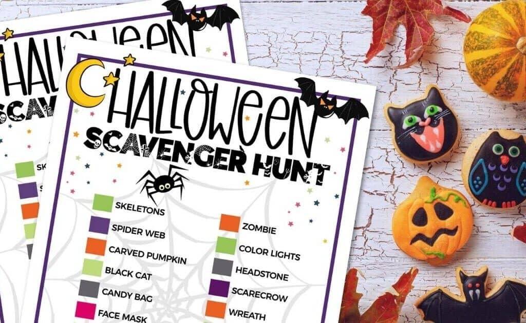 halloween painted rocks on table with halloween scavenger hunt printable