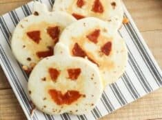 jack o lantern quesadillas on a plate