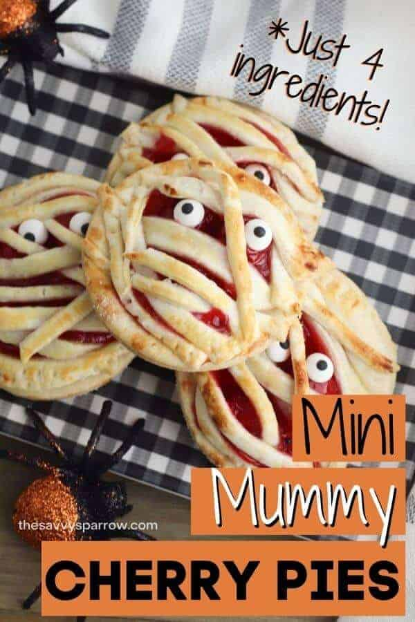 mini cherry pie mummy halloween treats stacked up on a plate