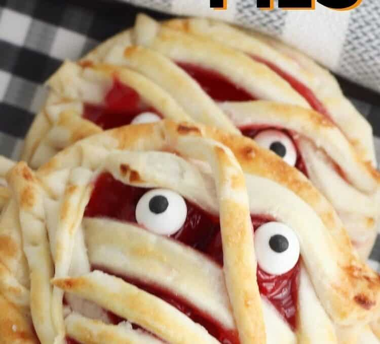 mummy cherry pies with text that says mini mummy cherry pies just 4 ingredients