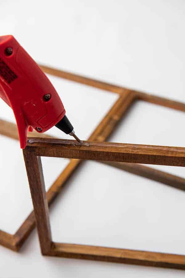 gluing stretch canvas frames together to form a DIY window frame