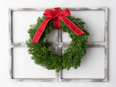 DIY farmhouse window frame wall decor with a wreath on top