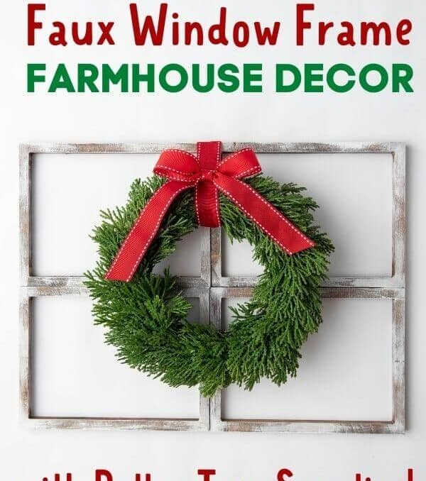 Christmas wreath on top of a DIY rustic window frame decor