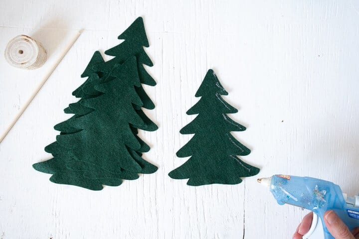 hot glue on the outer edge of one felt Christmas tree