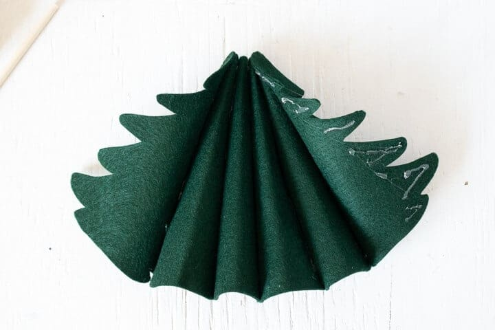 6 felt Christmas tree pieces glued together to form a 3D tree