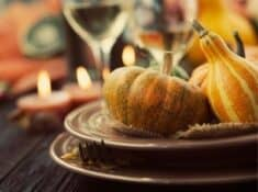 table setting decorated for hosting thanksgiving