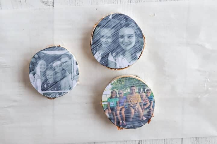 DIY wood slice photo ornaments with Mod Podge on top