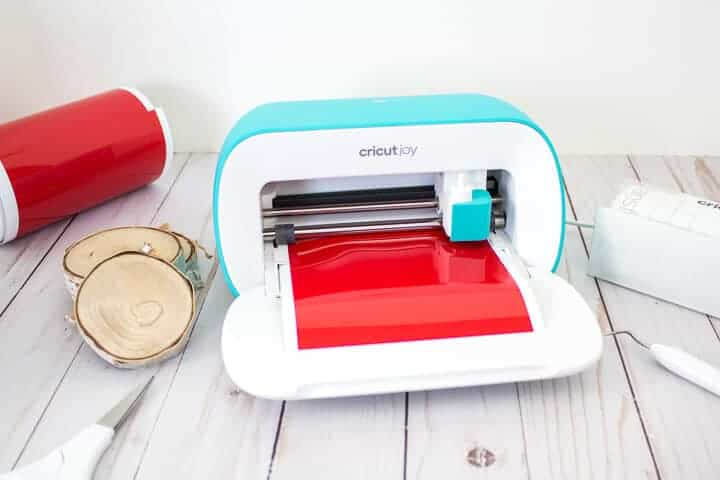 Cricut Joy machine with red vinyl loaded
