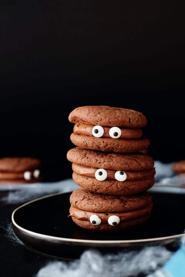 chocolate cookies with chocolate icing and candy eyeballs