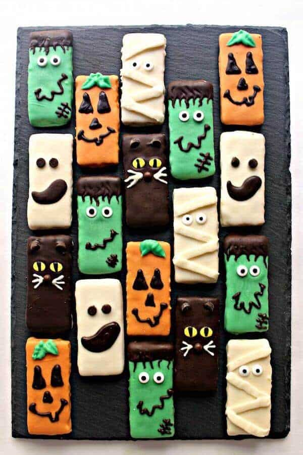 graham crackers decorated with colored melted chocolate for Halloween