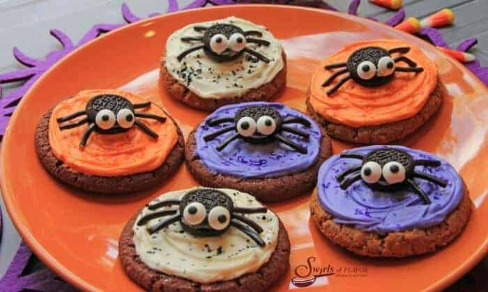 orange and purple Halloween cookies with spider decorations