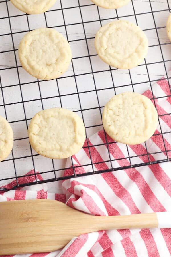sugar cookies cooling on a wire rack