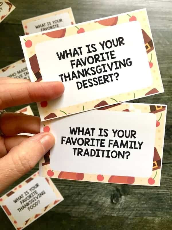 conversation cards that say What is your favorite family tradition and what is your favorite Thanksgiving dessert