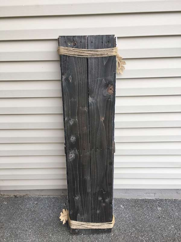 pallet wood nailed together to form a front porch sign