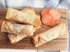 pizza egg rolls on a cutting board
