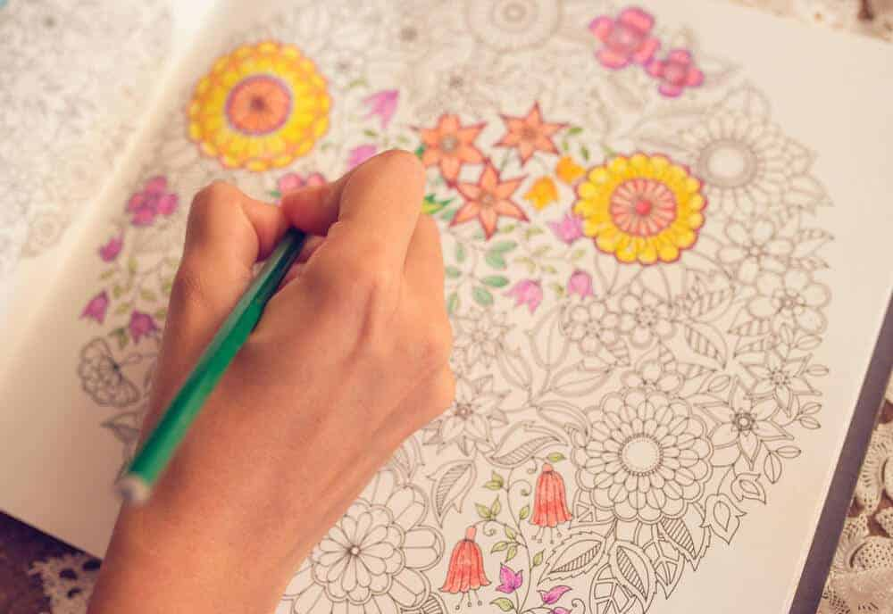 woman coloring in an adult coloring book