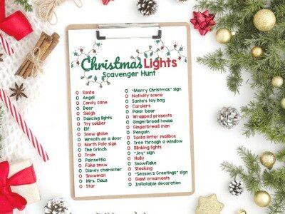 Christmas light scavenger hunt list on a clipboard